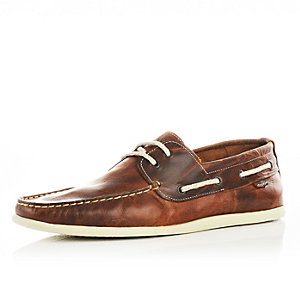 Tan brown leather boat shoes