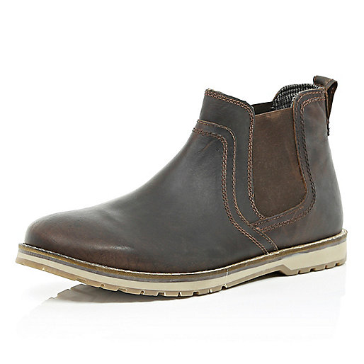 Dark brown cleated sole Chelsea boots