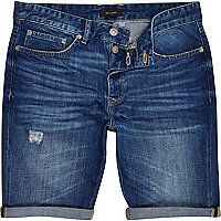 Mid wash distressed slim denim shorts