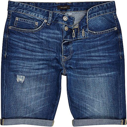 Mid wash distressed slim denim shorts