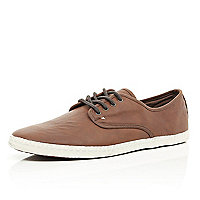 Tan lace up plimsolls