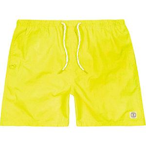 Fluro yellow short swim trunks