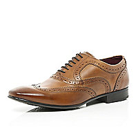 Tan formal wingtip brogues