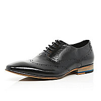 Black textured panel wingtip shoes