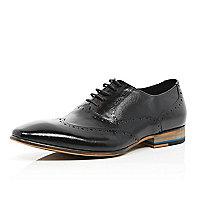Black textured panel wingtip shoes