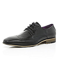 Black leather perforated wingtip shoes