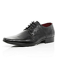 Black perforated textured shoes