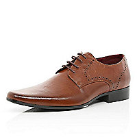 Tan perforated textured shoes