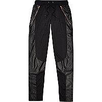 Black Panuu leather-look panel joggers