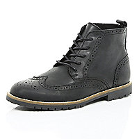 Black cleated sole brogue boots