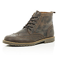 Brown cleated sole brogue boots