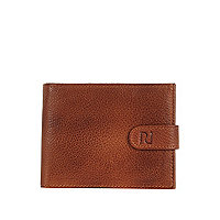 Brown leather fold over wallet