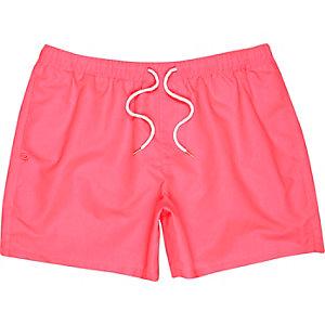 Neon pink swim shorts