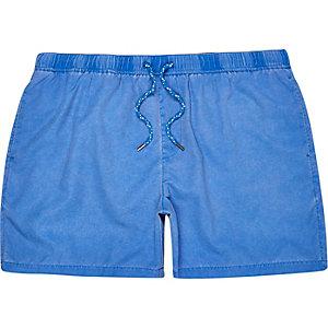 Blue drawstring swim trunks