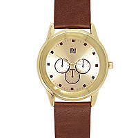 Brown classic gold tone face watch