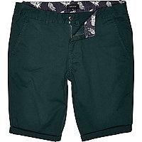 Green skinny chino shorts