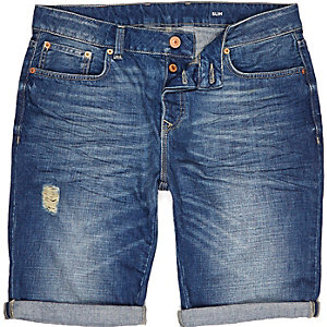 Mid wash denim distressed slim shorts