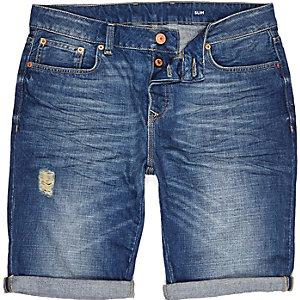Mid wash denim distressed slim shorts
