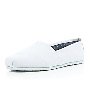 White canvas slip on plimsolls