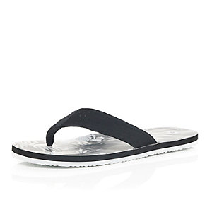 Black printed sole flip flops