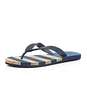 Blue stripe flip flops