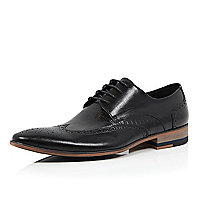 Black leather textured wing tip brogues