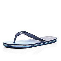 Blue striped sole flip flops