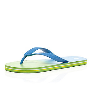 Green striped sole flip flops