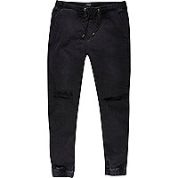 Black ripped knee drawstring joggers