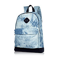 Blue acid wash denim backpack