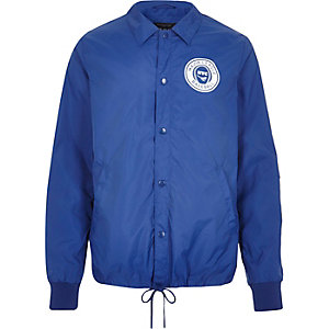Blue nylon NYC baseball coach jacket