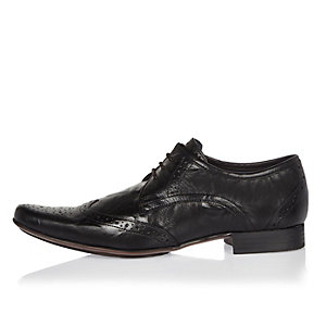 Black leather pointed brogues