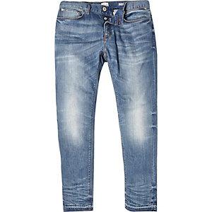 Mid wash unhemmed Eddy skinny stretch jeans