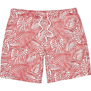 Red Hawaiian leaf print swim trunks