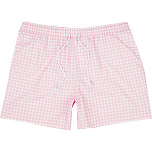 Pink gingham swim trunks
