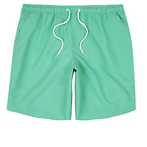 Green drawstring swim trunks