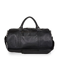 Black round holdall bag