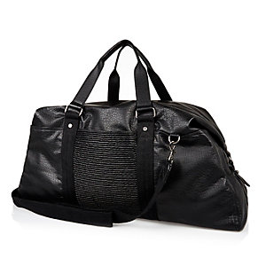 Black grungy holdall bag