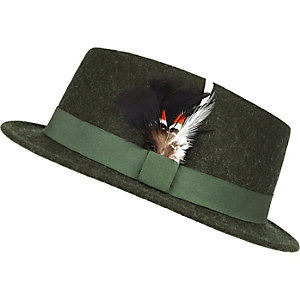 Dark green feather pork pie hat