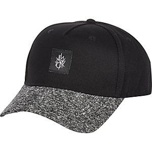 Black contrast peak trucker cap