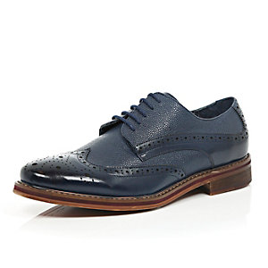 Navy blue pebbled leather brogues