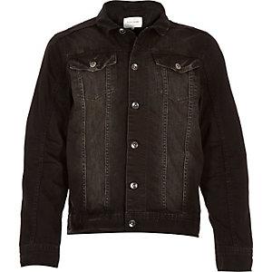 Worn black denim jacket