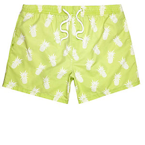 Green pineapple print swim trunks