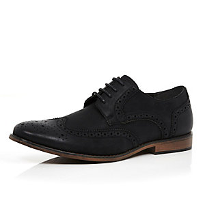 Black lace up wing tip brogues