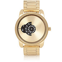 Gold tone concealed face watch