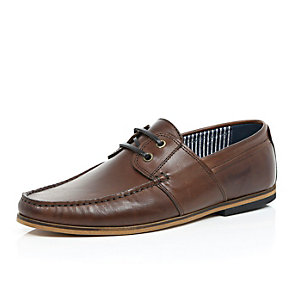 Brown leather lace up boat shoes