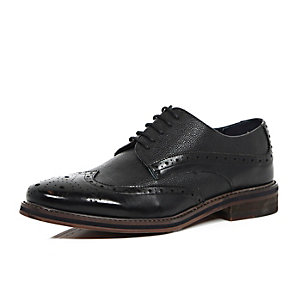 Black pebbled leather brogues