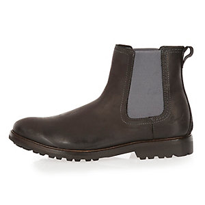 Black leather cleated sole Chelsea boots