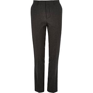 Dark grey pin stripe skinny suit trousers