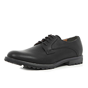Black cleated sole shoes